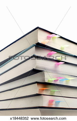 Stock Photo of Stack of books with page markers, low angle view.