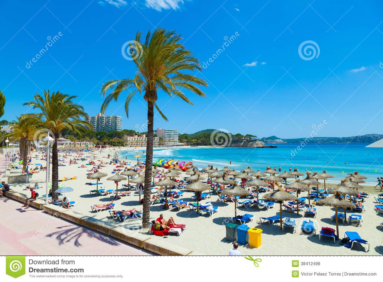 People Sunbathing At Paguera Beach, Majorca, Spain Editorial Stock.