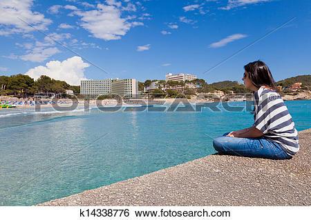 Stock Images of Girl Looking at Paguera Beach, Mallorca k14338776.