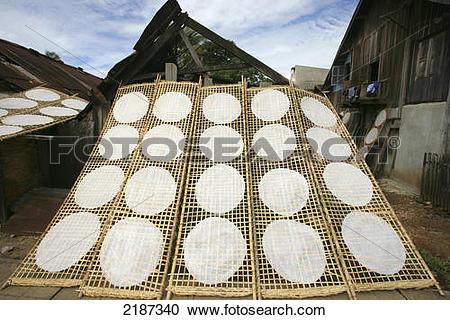 Stock Photography of Drying rice flour pancakes; Pakse, Champasak.