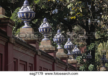 Stock Photograph of CERAMIC MOTIF atop the fence enclosing the.