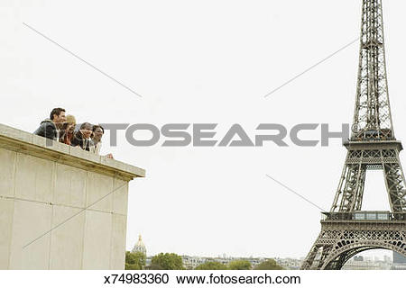 Stock Photography of France, Paris, two couples looking out from.