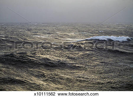 Stock Photo of Pale low sunlight on stormy fog.