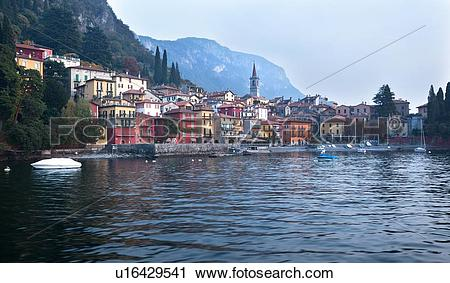 Stock Photography of View over lake of town of Varenna along lake.