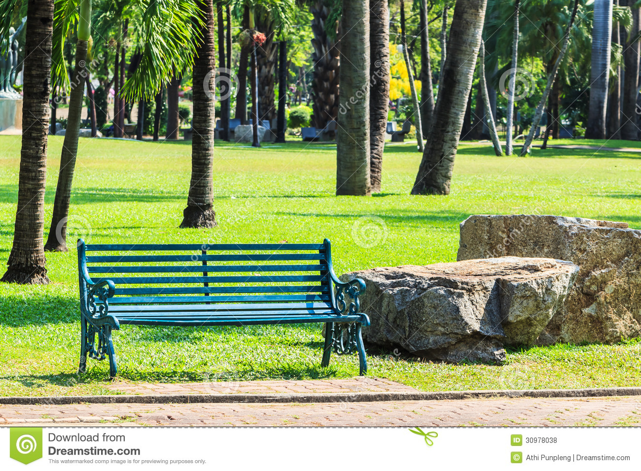 Green Bench In Palm Garden Background Royalty Free Stock Photos.