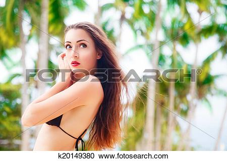 Stock Photography of Beautiful young woman with long hair in black.