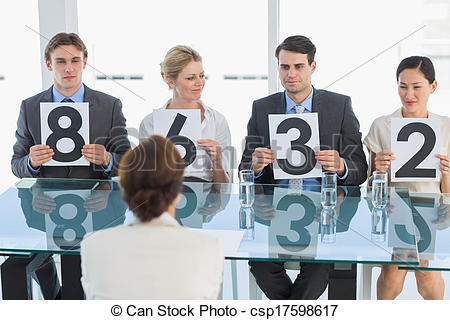 Stock Photography of Judges in a row holding score signs.