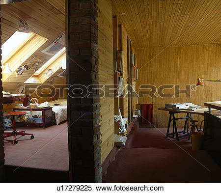 Stock Image of Panelled wall between attic bedroom and study with.