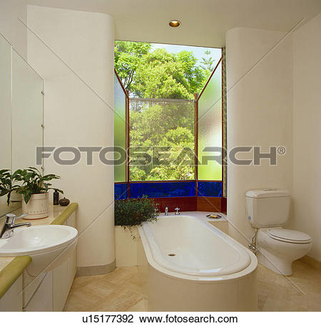 Stock Photo of Large window with blue stained glass panel behind.