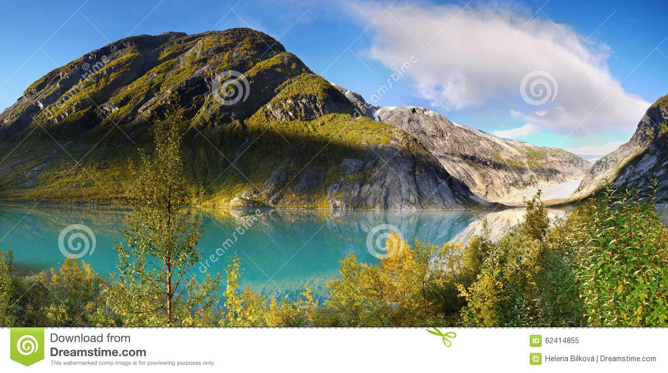 Norway Glacier Lake Sunrise Mountains Stock Photo.