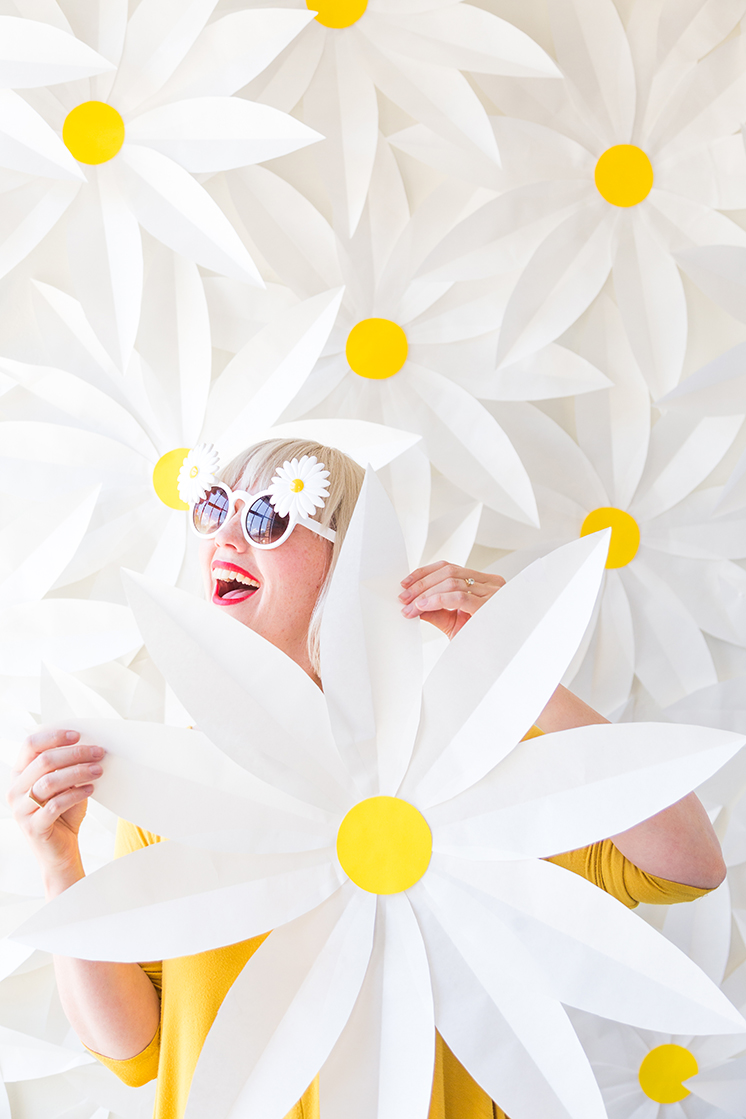 DIY Paper daisy backdrop and video.