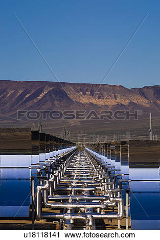 Stock Photography of Oil pipes and parabolic mirrors at the Solar.