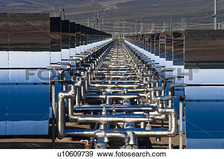 Stock Photograph of Oil pipes and parabolic mirrors at the Solar.