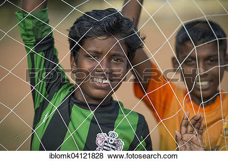 Pictures of Boys looking through goal net, Parade Ground, Fort.