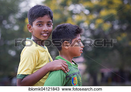 Stock Photo of Two boys during a short break at a football game.