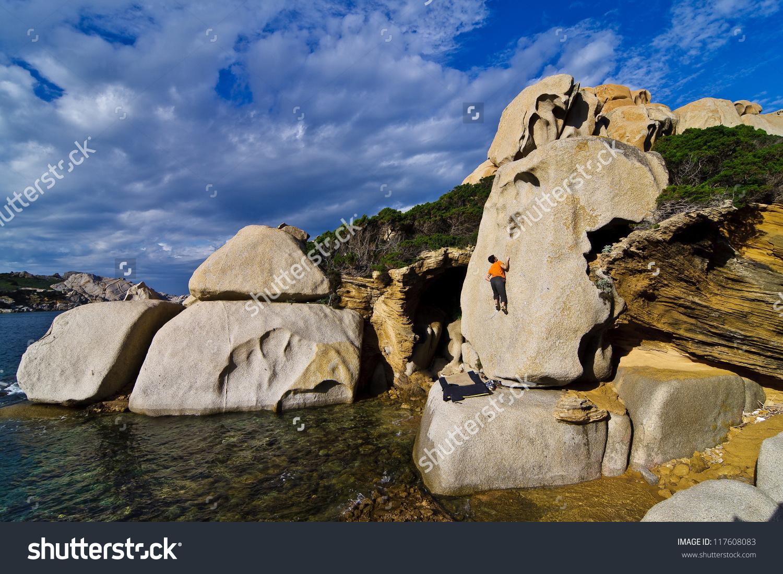 Climber In The Paradise Of Capo Testa, Sardinia, Italy. Stock.