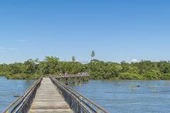 Tourists Crossing The Bridge At Parana River In Iguazu Falls Stock.