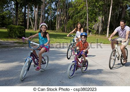 Stock Photos of Modern Family Parents and Children Cycling.