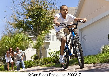 Picture of African American Family WIth Boy Riding Bike & Happy.