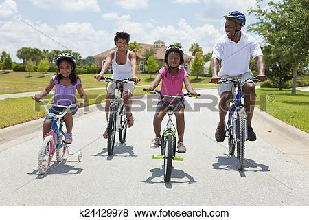 Pictures of African American Family Parents and Children Cycling.