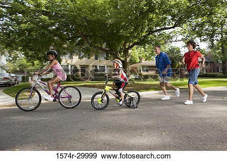 Stock Photograph of Children riding bicycle on the road while.