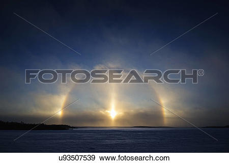 "Stock Photograph of ""A Sundog, Parhelia or Mock Sun, is created by."