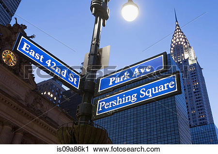 Stock Photography of Pershing Square and Park Avenue street signs.