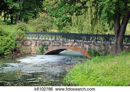 Stock Images of Old park bridge at spring, Alexandria, Ukraine.