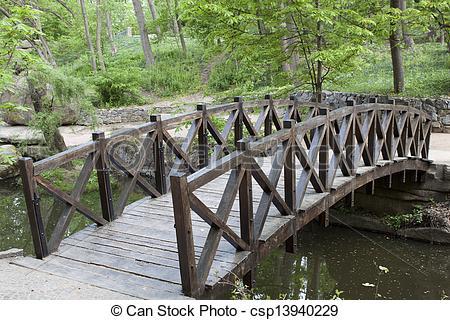 Clip Art of Wooden bridge over a small river in Sophia park in.
