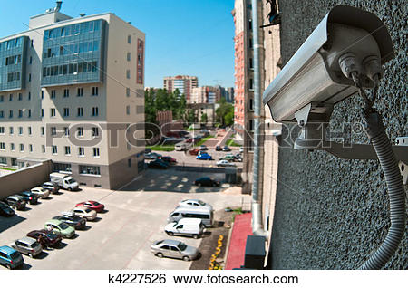 Stock Images of Optical camera on wall of building watching on.