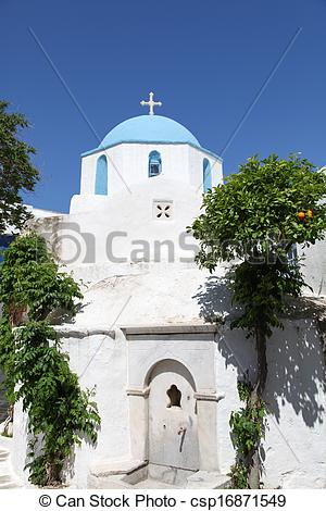 Stock Photo of Church and orange tree on Paros island in the.