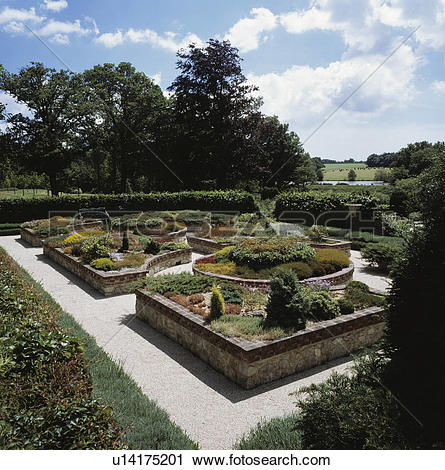 Stock Photography of Walled raised beds in formal parterre garden.