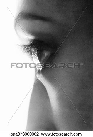 Stock Photo of Partial view of woman's face, side view, blurred.
