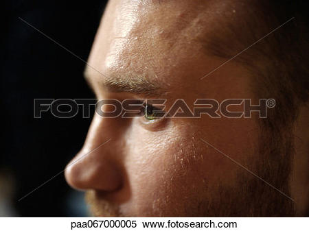 Stock Image of Partial view of man's face, close up, side view.