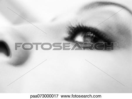 Picture of Partial view of woman's face, low angle view, black and.