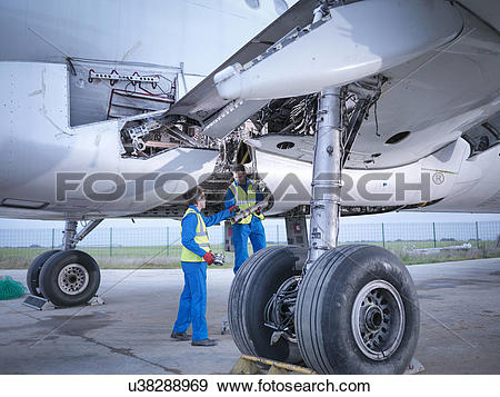 Stock Photograph of Engineers recycling aircraft parts from.