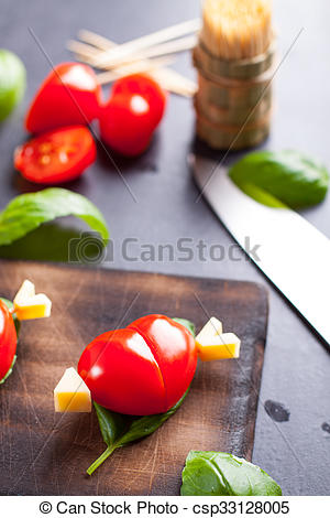 Stock Photography of Marinated fillet with tomato heart shaped.