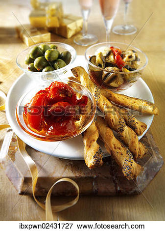 """Picture of """"Italian Party buffet food with dried tomatoes, bread."""