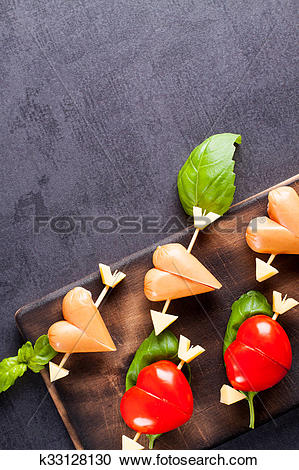 Stock Photography of Marinated fillet with tomato and sausage.