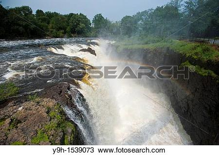 Stock Photo of Thousands of gallons of water cascade over the.