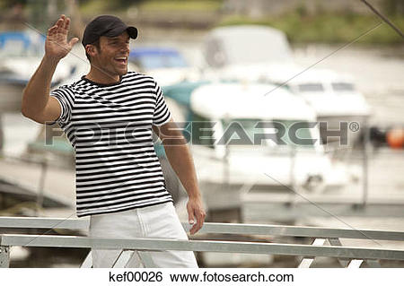 Stock Images of Germany, Passau, Danube river, Man waving with.