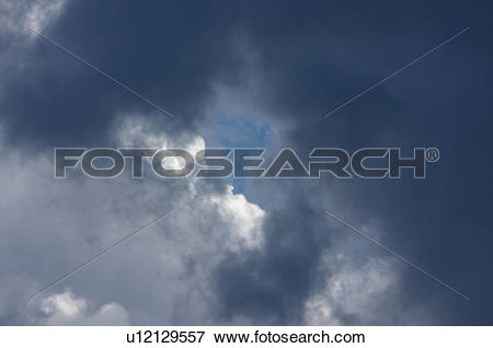 Picture of Storm clouds and patch of blue sky u12129557.