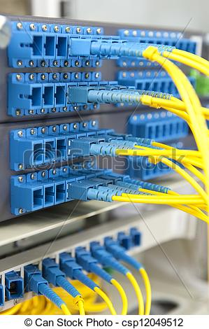 Stock Photography of fiber optical network cables patch panel and.
