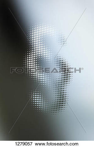 Picture of Dot patterned section sign mixed in shadow and light.