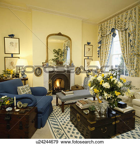 Stock Photograph of Traditional yellow living room with blue.