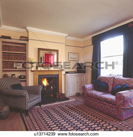 Stock Photograph of Patterned oriental rug on wooden flooring in.