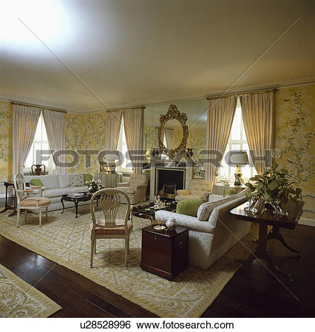 Stock Images of Patterned yellow wallpaper and rug in traditional.