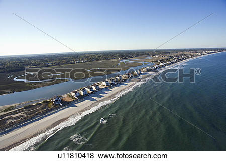 Pictures of Aerial view of houses in row on beachfront of Pawleys.