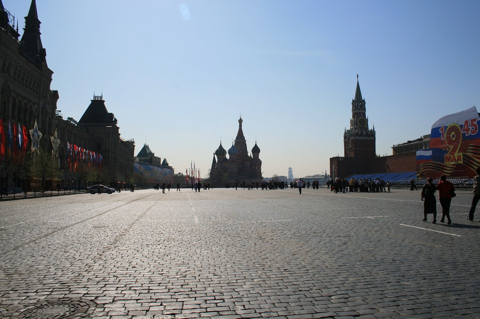 Free photo Red Square Open Space Paving Open Blue Sky.