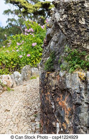 Stock Photo of walkway paved road turn around rock.